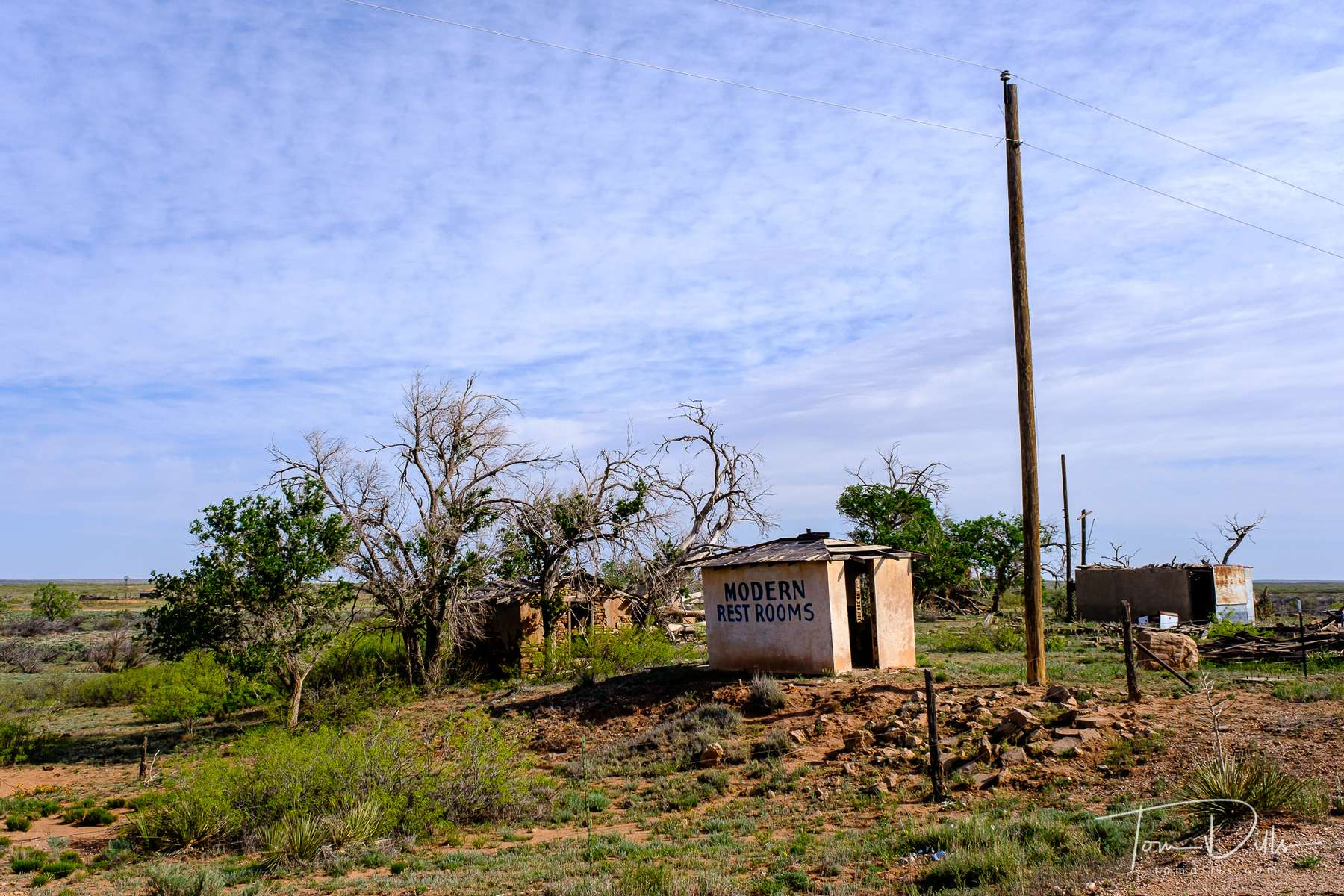 Abandoned buildings along a dirt road stretch of Historic Route 66 near the New Mexico-Texas border