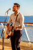 Singer and guitarist Chris Hawkes performs at the Sunset Bar aboard Celebrity Summit