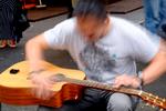 Guitarist {quote}Adam Kadabra{quote} performs during the Fringe Festival in Edinburgh