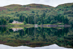 Royal Cottage on the shore of Loch Katrine from aboard the steamship Sir Walter Scott