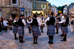 Bagpipers performing in downtown Inverness