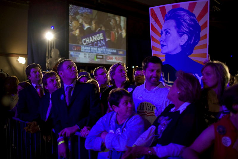 Supporters of Sen. Hillary Clinton inspect a campaign poster while awaiting the Senator's victory speech after winning the Indiana Primary.