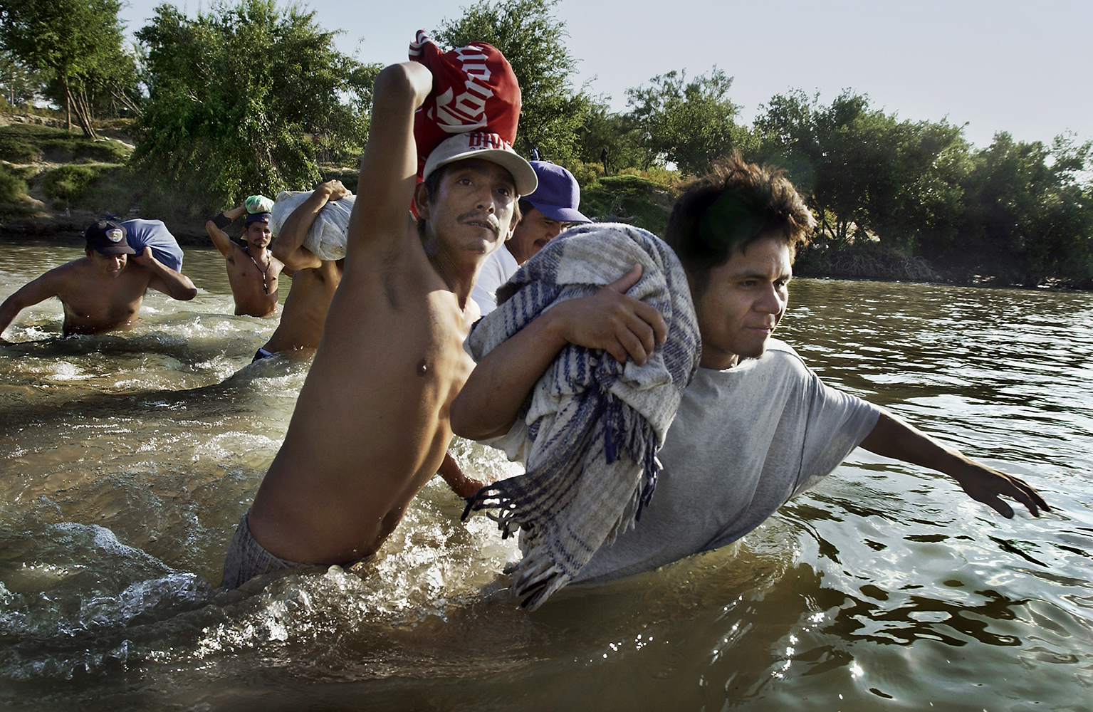 {quote}IN OUR OWN BACKYARD: U.S. Poverty in the 21st Century{quote}Desperately poor illiegal  imigrants make the treacherous crossing from Mexico to the United States on the Rio Grande River near Laredo in South Texas.