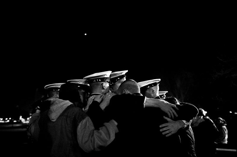 As night falls, cadets gather to comfort one another and their fellow classmates outside of the campus chapel.