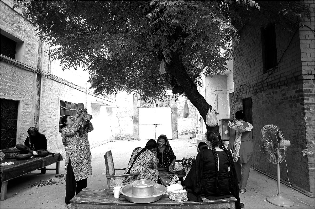 Women gather in the courtyard of the shelter.