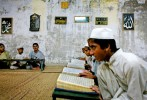 While memorizing the Koran, madrassa students rock back and forth, their voices merging as they recite different verses aloud. It is believed that the rocking motion helps with memorization.