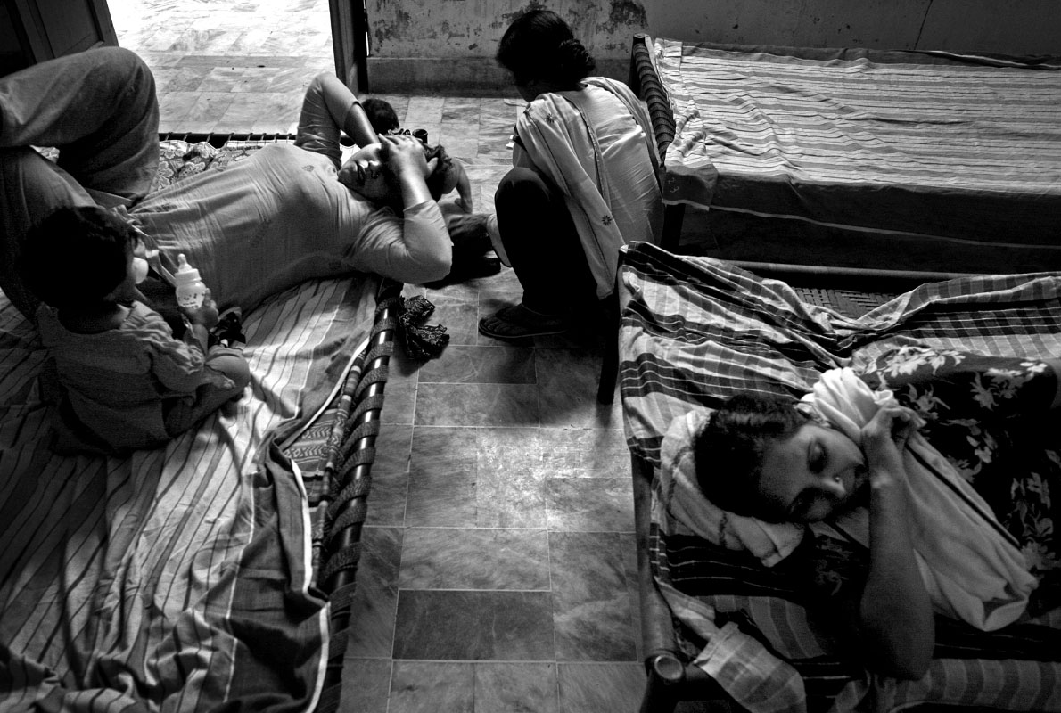 Women rest on beds in the cramped quarters of the shelter. Because lawyers are costly and can only be arranged by relatives or the government, many women have no choice but to stay in the shelter for months or even years.