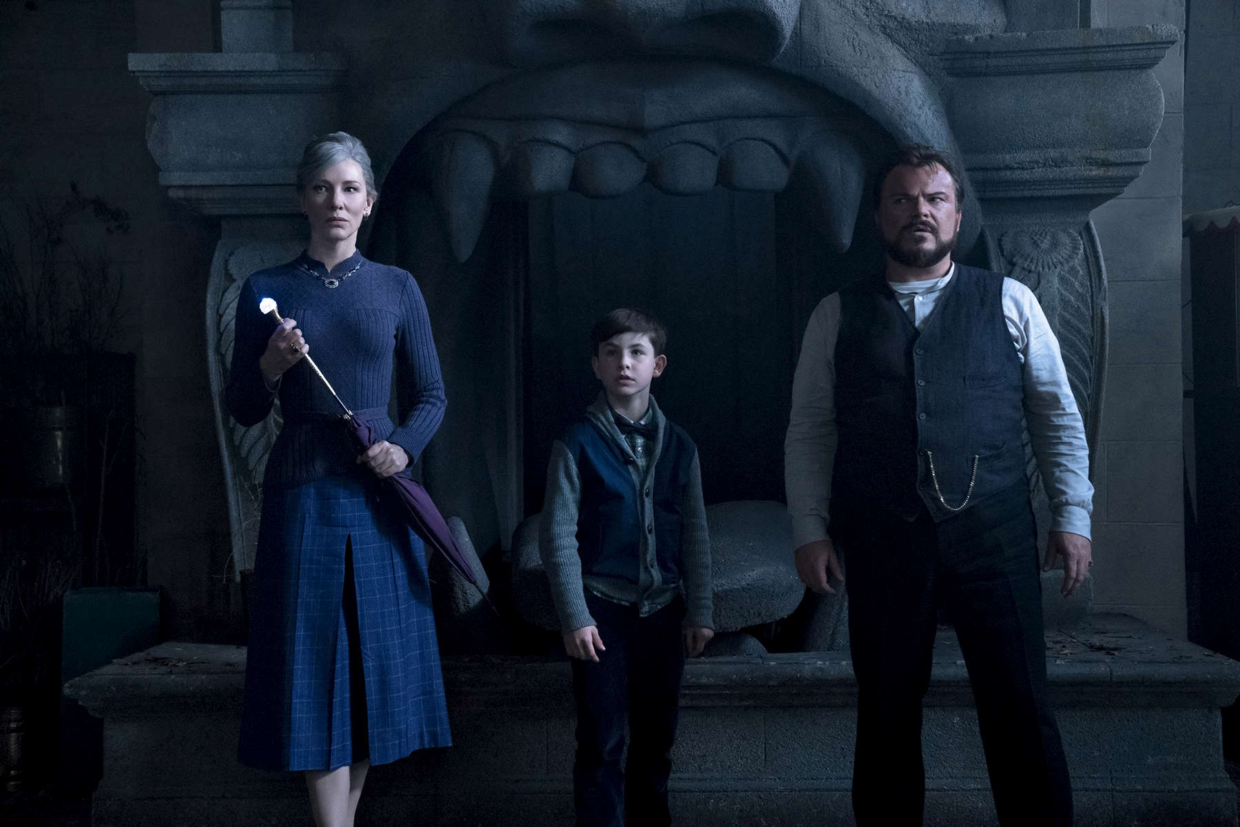 (L to R) CATE BLANCHETT, OWEN VACCARO and JACK BLACK star in The House with a Clock in Its Walls, from Amblin Entertainment.  The magical adventure tells the spine-tingling tale of 10-year-old Lewis (Vaccaro) who goes to live with his uncle (Black) in a creaky old house with a mysterious tick-tocking heart.  But his new town's sleepy façade jolts to life with a secret world of warlocks and witches when Lewis accidentally awakens the dead.