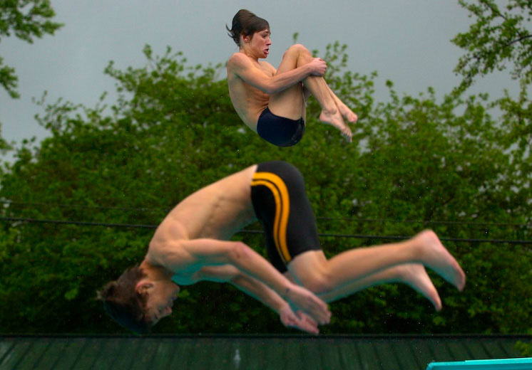 Yuba City High diving team members Michael Anrdrous, 16, top and Matthew Nesting, 15, practice at the Sam Brannan Park pool.