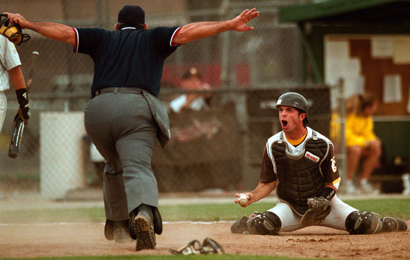 Yuba City High catcher Matt Gunderson contests a call by home plate umpire Ernie Garcia in the sixth inning of their game against Del Campo High.
