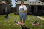Retired Air Force Tech. Sgt. Jerry Kester makes and displays crosses on his lawn in memory of those lost in conflict.