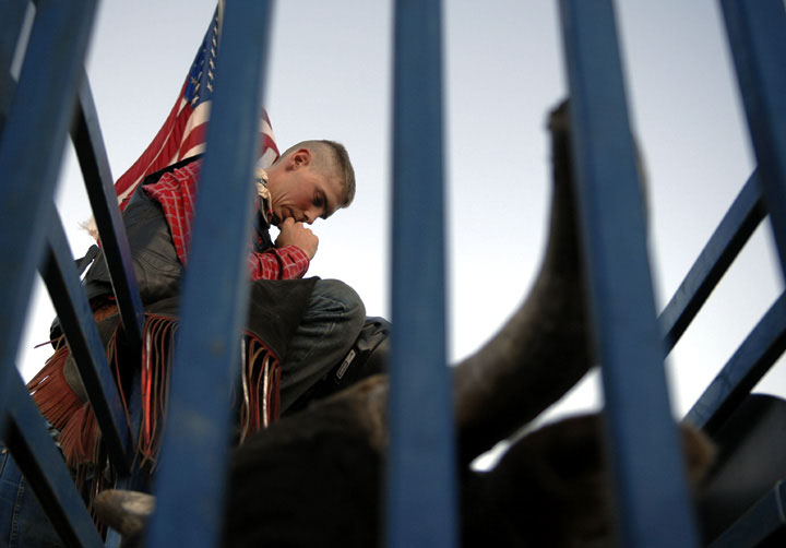 Derek McCormack, with the Professional Bull Riders Discovery Tour, prays in the chute before riding a bull at the Yuba-Sutter Fairgrounds.