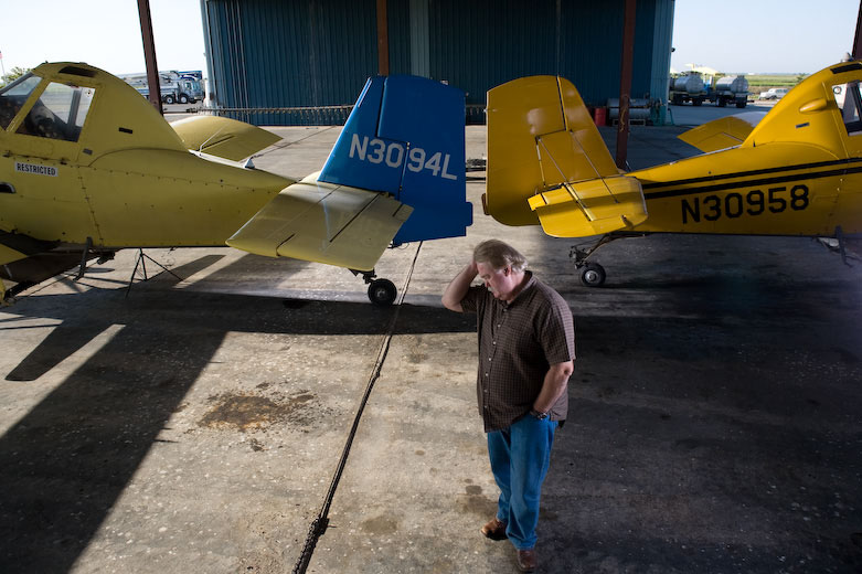 Farm Air Flying Services co-owner Bill Porter with two of the aerial application, or crop duster planes in the fleet. Farm Air's origins lie in the days after World War II but its future is uncertain: Sacramento's sprawl is slowly filling up traditional rice acreage, drying up demand for crop dusting services. Meanwhile, Porter has no apprentice to carry on the business when he retires—a common problem across the aerial-application industry.