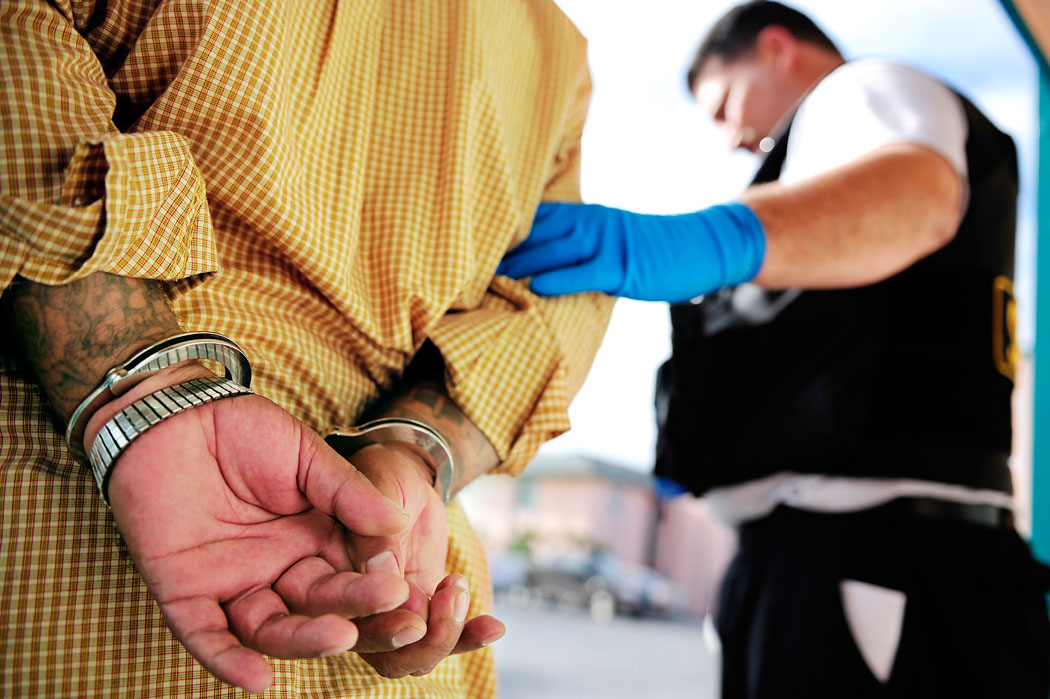 A sheriff participating in the SAFE Sweep parole check arrests a parolee for violating the terms of his parole Wednesday in Salinas. The SAFE Sweep went throughout Monterey County to check the parole of registered sex offenders, searching their homes and vehicles. This parolee was found with a crowbar and a knife that were classified as weapons because he had a prior conviction for using a crowbar to sexually assault a woman.