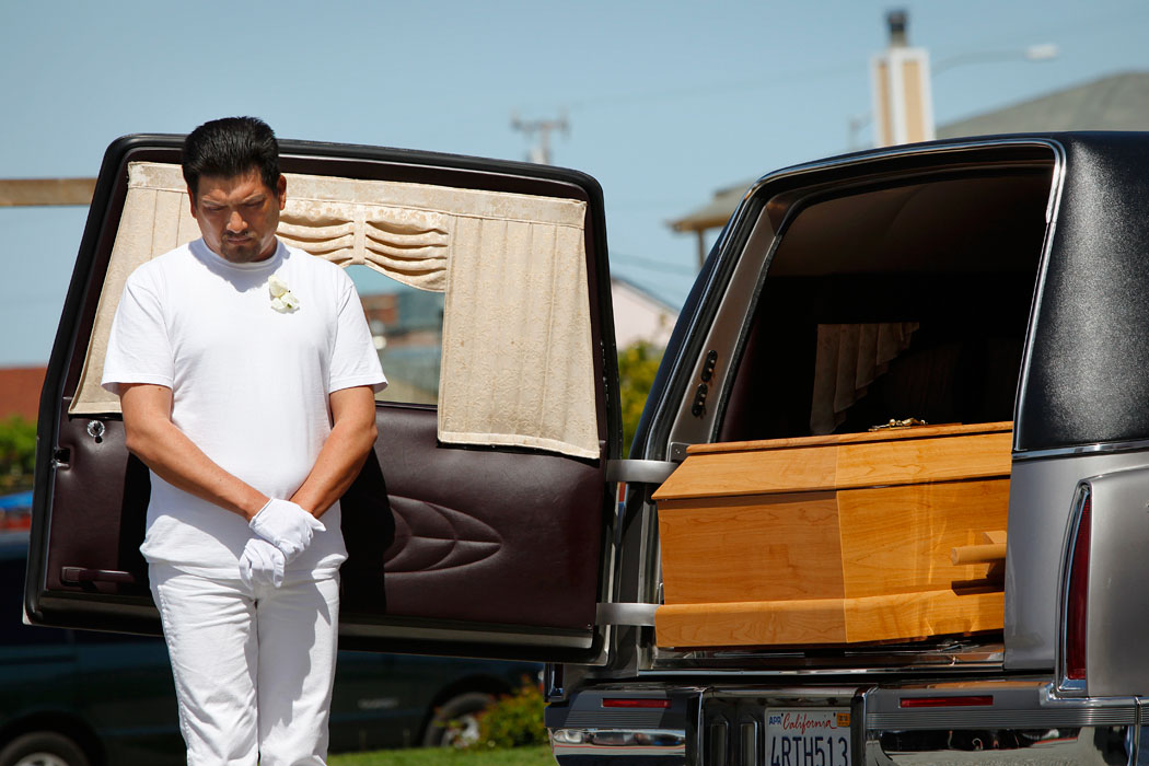 Jose Cruz stands by the coffin of his 6-year-old son, Azahel Cruz, before a funeral mass Friday at St. Mary of the Nativity Church in Salinas. Azahel Cruz was shot and killed by a stray bullet at his home along Laurel Drive last Tuesday.