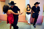 Performers in the Canta Sin Verguenza Talent Show relax with their own music and dancing backstage Saturday in Watsonville.