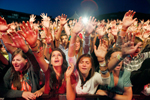 Fans of the band Family Force 5 join in prayer during Thursday's Spirit West Coast, a three-day Christian music festival at Laguna Seca.