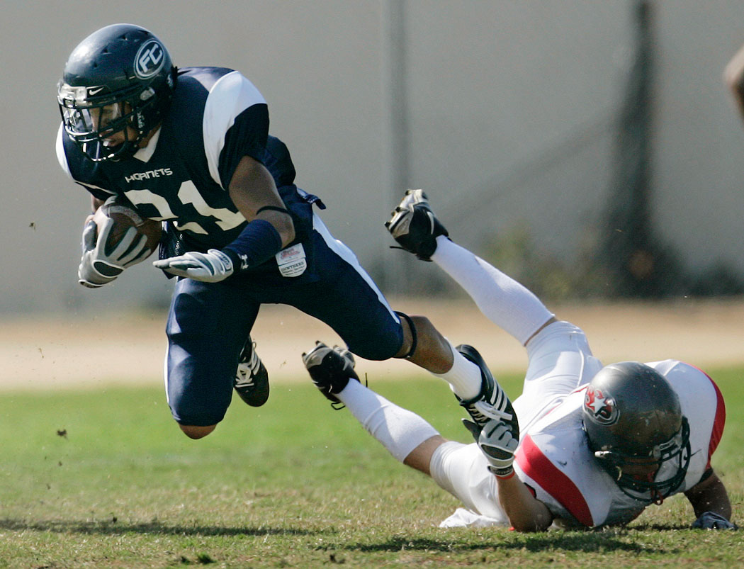 Fullerton College's Matt Estrada is brought down by a lucky toe grab during a punt return, in Fullerton's unexpected 47-17 blowout win against Palomar College.