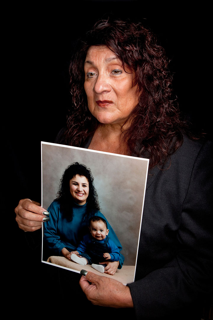 Angie Ortega holds a picture of her late daughter Lorraine Ortega. Lorraine was fatally beat and stabbed October 1, 1993 in Salinas.