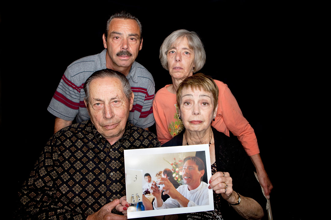 From the top left, Rusell Auria, Becky McCallon, Louis Auria and Claudine Auria hold a picture of their late brother and son Mark Auria. Mark was assaulted and suffered major head trauma resulting in his death December 22, 2010 in Marina.