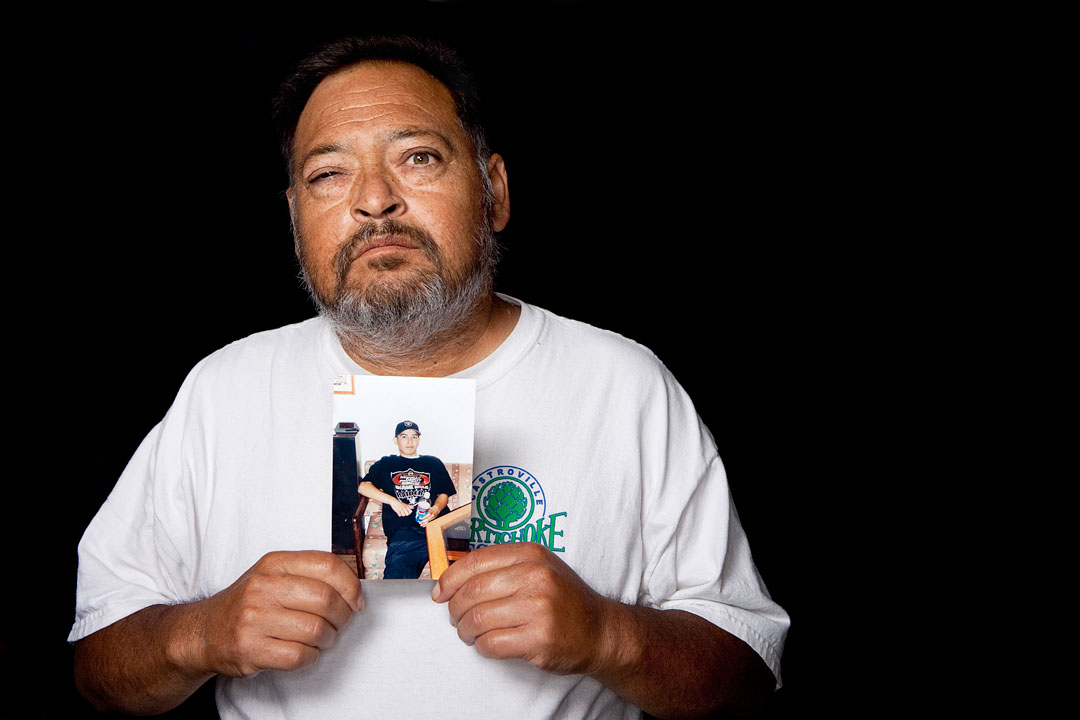 Ray Torres holds a picture of his late son Chris Torres. Chris was fatally stabbed in the heart during a gang related altercation October 1, 2006 in Castroville.