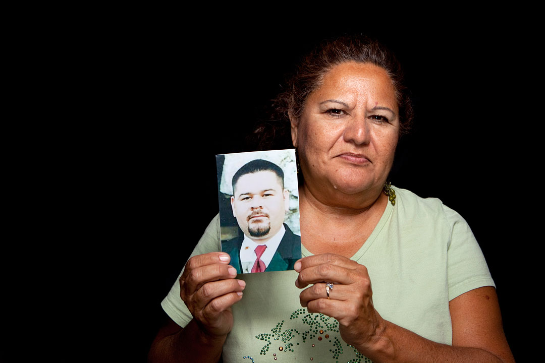 Elsa Sandoval holds a picture of her late son Joey Sandoval. Joey was shot and killed outside their home March 29, 2003 in Salinas.