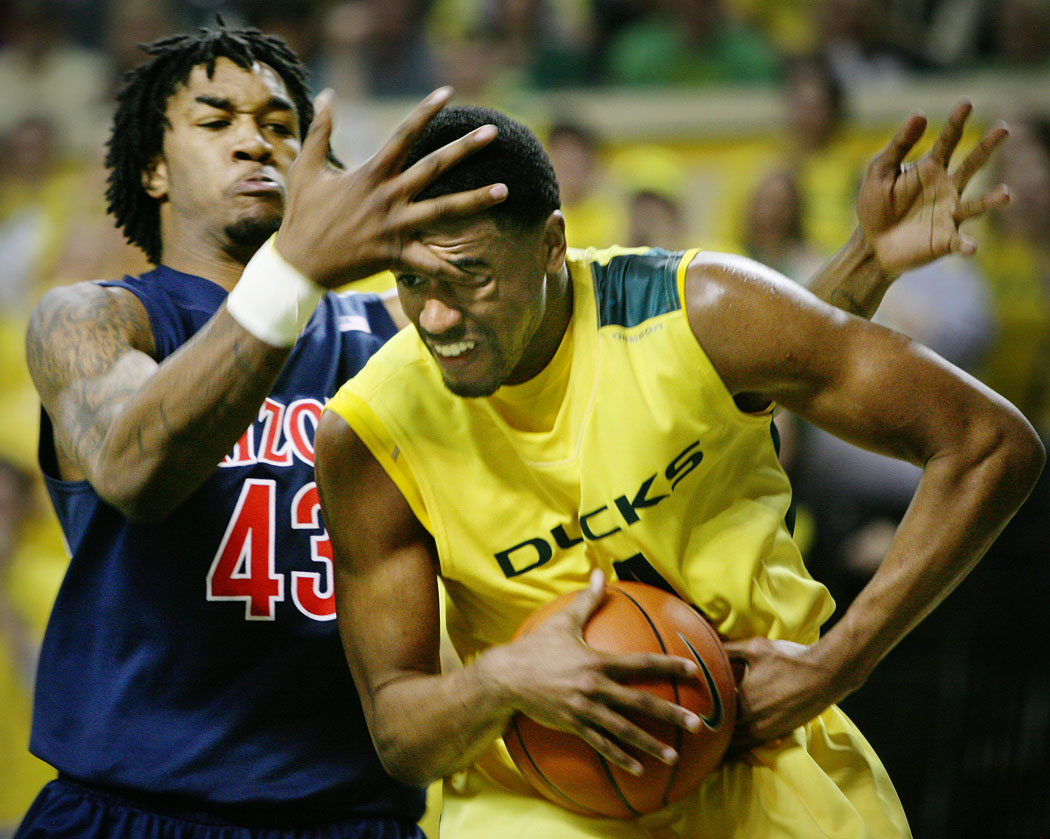 Oregon's Bryce Taylor gets an eyeful from Arizona's Jordan Hill during the Duck's 78-69 win at Mac Court. Although temporarily stunned by the jab in the eye, Taylor did not suffer any injury.