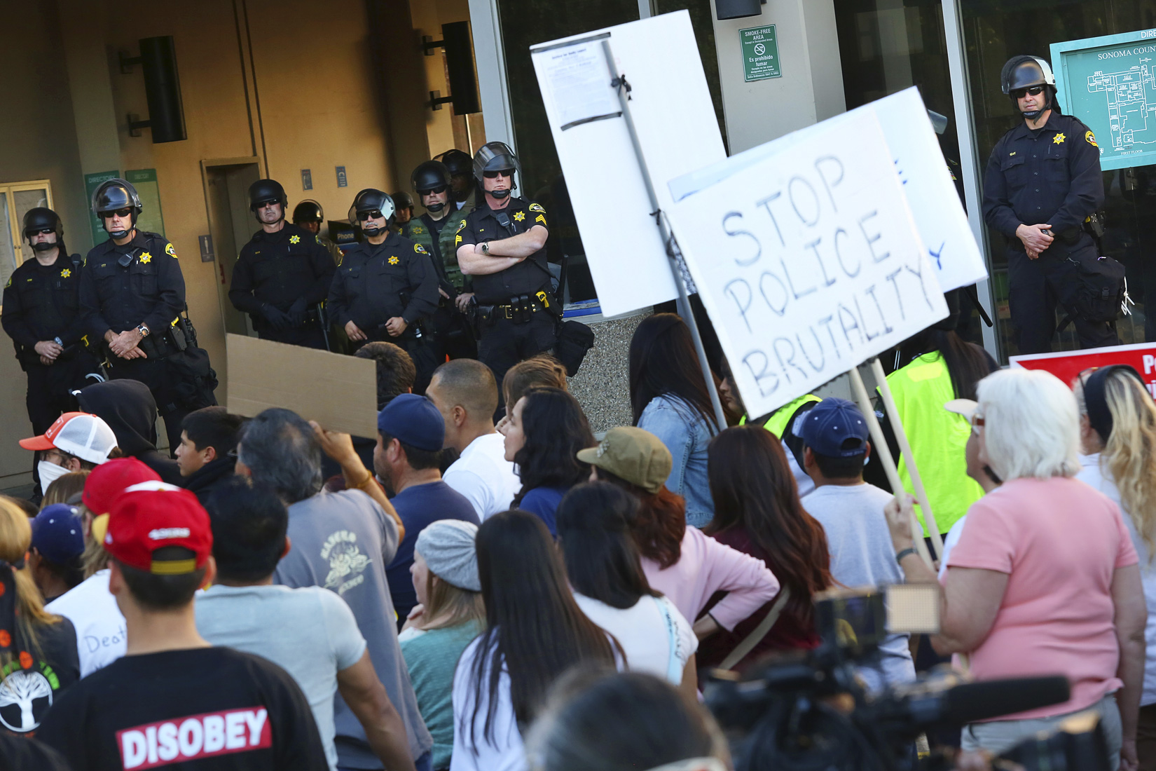 Sonoma County Sheriff officers in riot gear protect the County of Sonoma Office of the District Attorney during a protest over death of Andy Lopez in Santa Rosa on Tuesday, November 5, 2013. (Conner Jay/The Press Democrat)