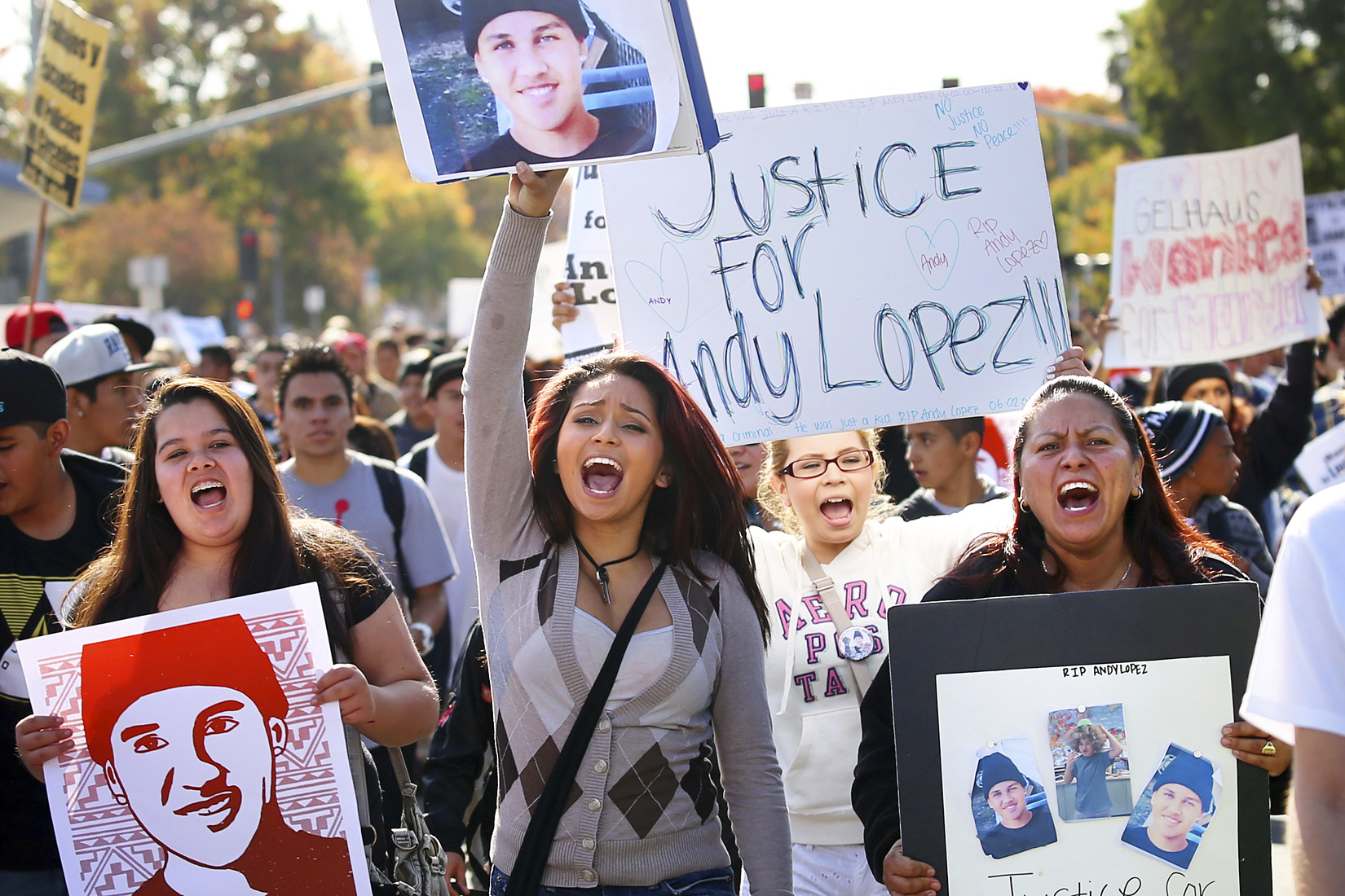 Rosiee Meraz, center, marches towards the Sonoma County Sheriff's offices during a protest over the death of Andy Lopez in Santa Rosa on Tuesday, October 29, 2013. (Conner Jay/The Press Democrat)