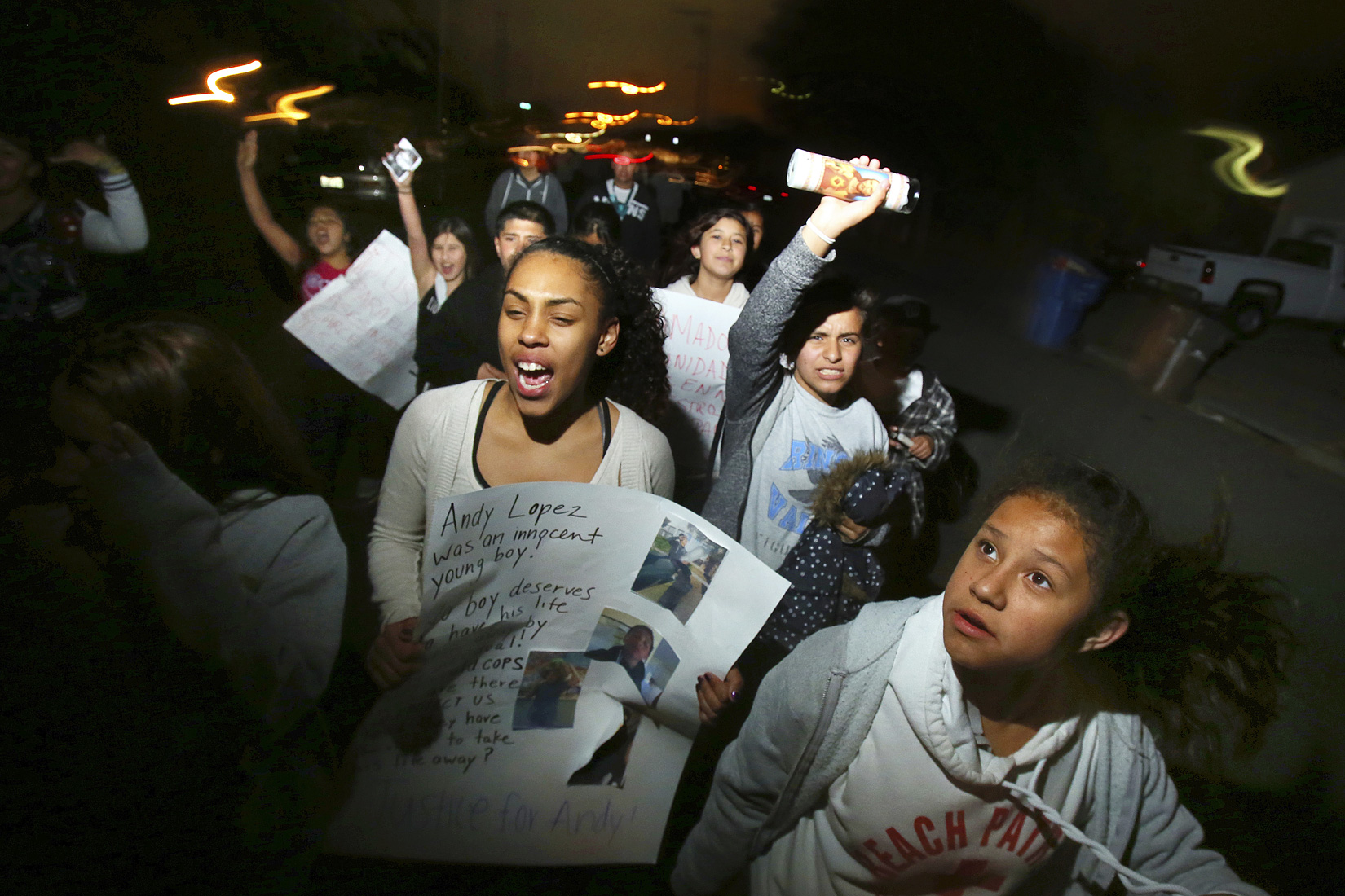 Students from Elsie Allen High School and Lawrence Cook Middle School march towards the site where 13-year-old Andy Lopez was shot and killed by a Sonoma County sheriff's deputy near the corner of Moorland and West Robles avenues in Santa Rosa, October 23, 2013. (Conner Jay/The Press Democrat)