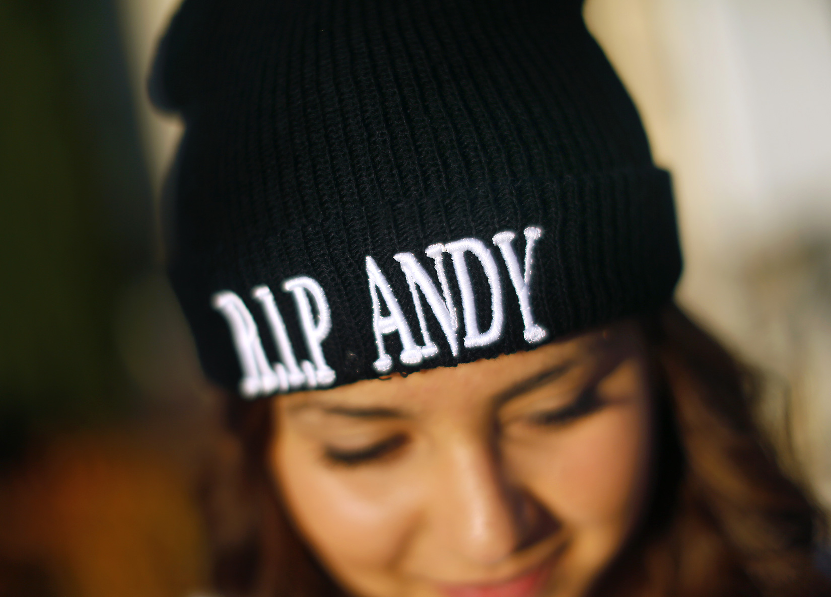 Esmeralda Mendoza, 14, wears a beanie with honoring her classmate Andy Lopez during a funeral service and viewing for Lopez at the Windsor-Healdsburg Mortuary on Sunday afternoon, October 27, 2013. (Conner Jay/The Press Democrat)