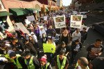 Demonstrators make their way through the streets towards the County of Sonoma Office of the District Attorney to protest the death of Andy Lopez in Santa Rosa on Tuesday, November 5, 2013. (Conner Jay/The Press Democrat)