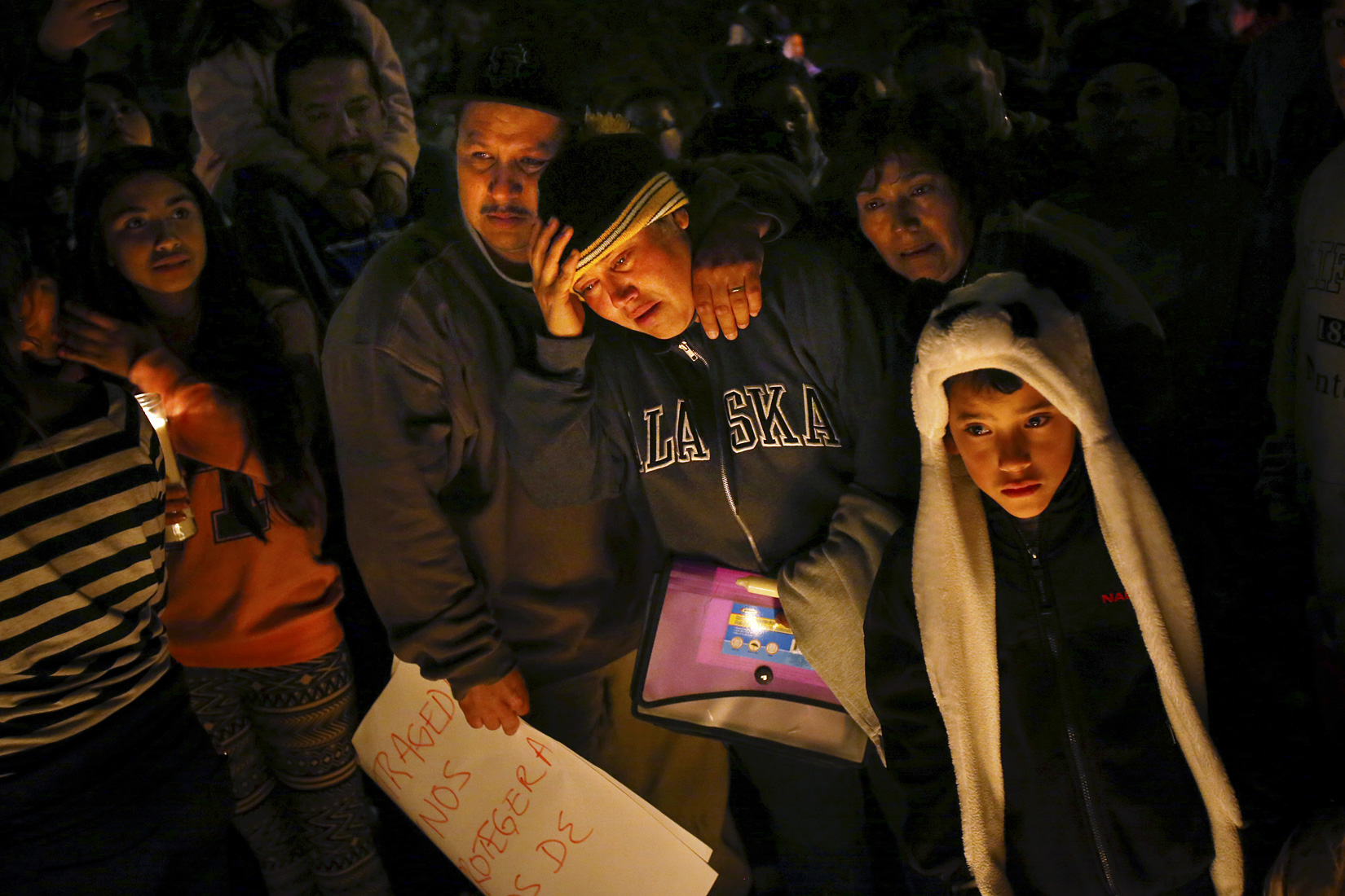 Sujey Lopez and her husband Rodrigo Lopez grieve at the site where their 13-year-old son Andy Lopez was shot and killed by a Sonoma County sheriff's deputy near the corner of Moorland and West Robles avenues in Santa Rosa, October 23, 2013. (Conner Jay/The Press Democrat)