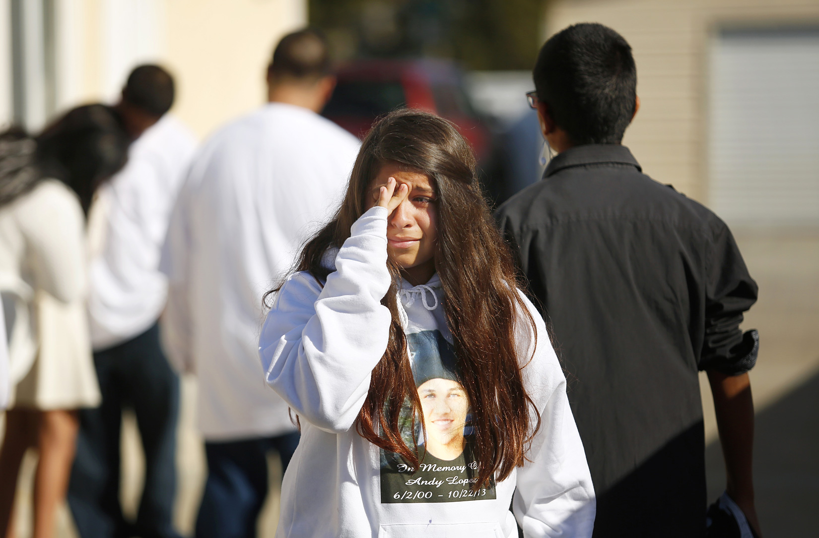 Aliyah Martinez wipes away tears after leaving a memorial service and viewing of Andy Lopez at the Windsor-Healdsburg Mortuary on Sunday afternoon in Windsor, October 27, 2013. (Conner Jay/The Press Democrat)