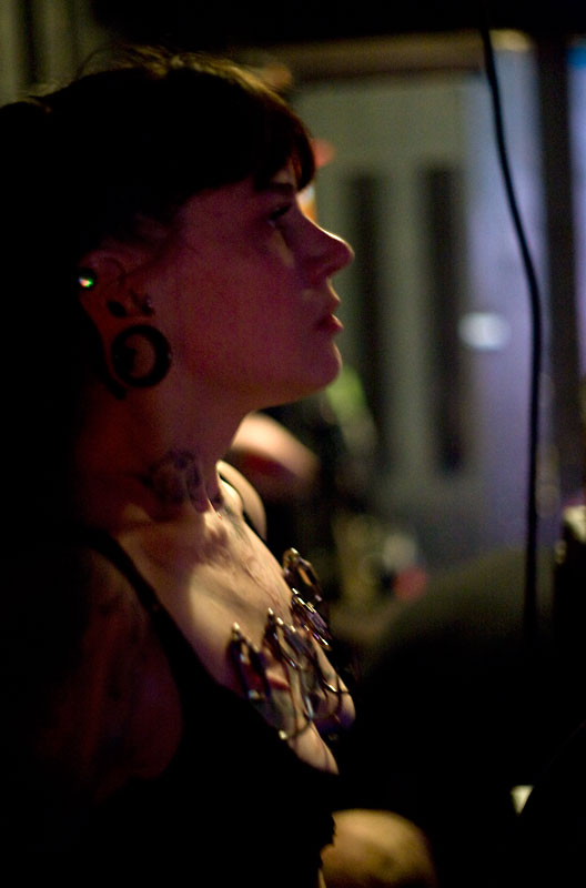 Terri Orlaske waits to go on stage to perform a full chest-only suspension.