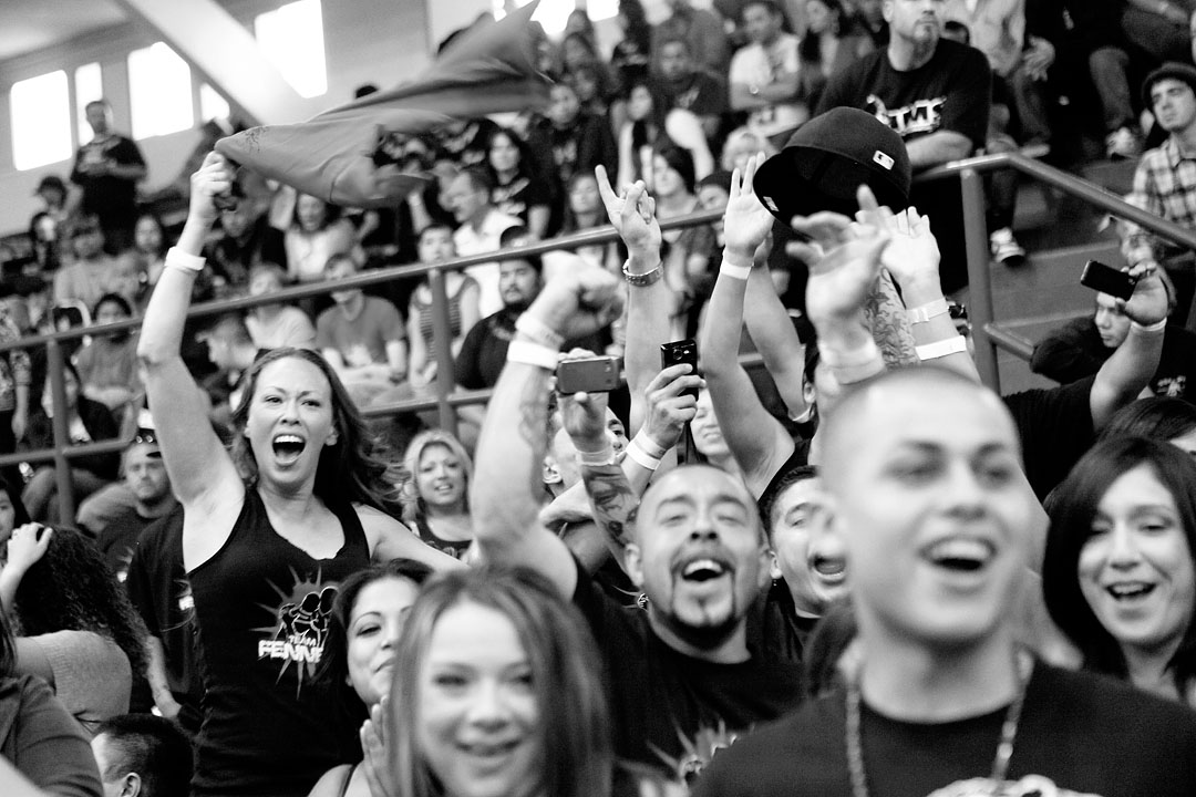 Local fans of Richard Fennel scream as he makes his entrance in the Central Coast Throwdown at Palma High School. The private high school was the site of the first three MMA events in Salinas, but recently withdrew its offer to host the fights. David Sullivan, Palma principal and a professed MMA fan, said he received enough complaints about the events to reconsider the money they were bringing in from the sold out events.