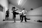 """Fatai Bailala of East Palo Alto warms up in the Palma High School's locker room before his fight at the Central Coast Throwdown in Salinas.""""The progress of our sport requires us to maintain a higher level of regulation than most other sports,"""" said J.T. Steele, president of Los Angeles-based California Amateur Mixed Martial Arts Organization. Along with insurance that includes accident and health coverage, each fighter must undergo a physical and medical screening for diseases such as HIV and hepatitis before being licensed by the California State Athletic Commission to compete."""