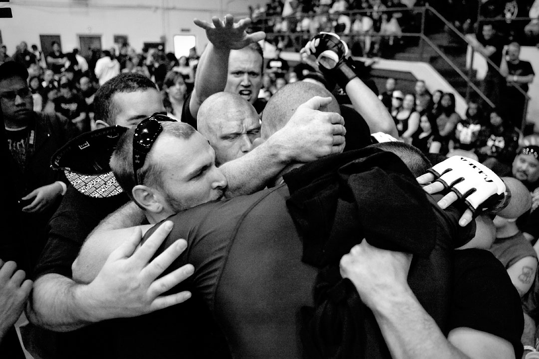 Matt Painter gets a group hug of support before entering the cage for his fight against Steve Dickie.