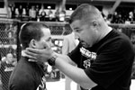 Local promoter Michael MacNeill consoles Dustin Moore of Santa Cruz after Moore suffered a loss to Jose Marin of Salinas in the Central Coast Throwdown in Salinas. {quote}You fought your ass off and just gave these people a hell of a show,{quote} said MacNeill.