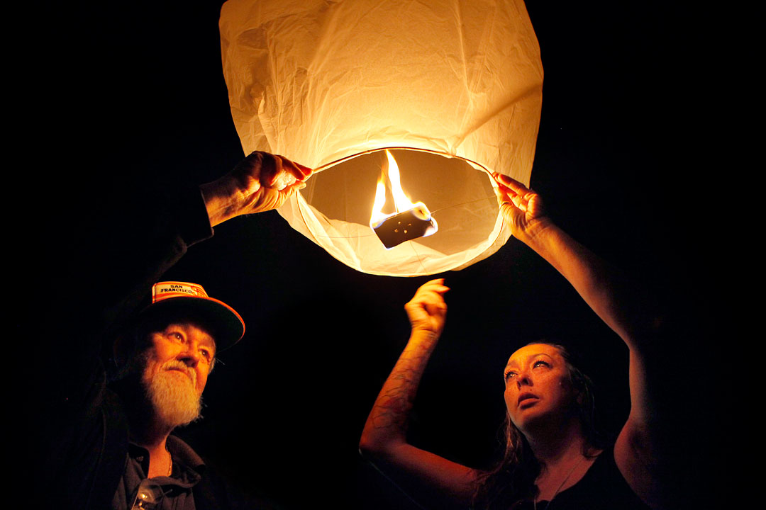 Tom Stone and Roben Vargas release a Chinese lantern with a written message to their late son late Salvatore Vargas on Friday in Prunedale. The lanterns which, floated into the night sky, were meant to celebrate the life of Salvatore who was shot and killed August 15 in Castroville.