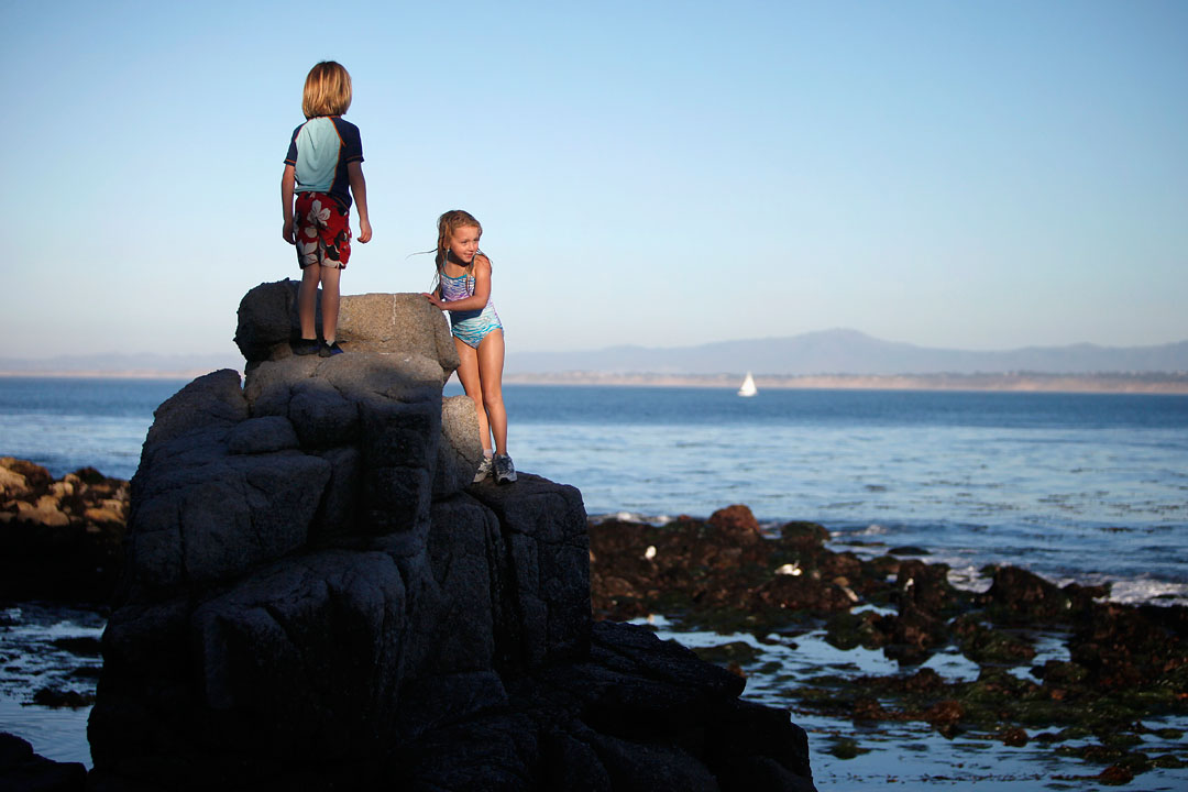 Jett Clarkson, 7, and Alexa Mayer, 6, take advantage of Thursday's warm weather with their families along the beach at Lovers Point Park in Pacific Grove. If you've taken advantage of the Spring-like winter weather with an evening stroll yet, don't worry, according to the National Weather Service this weekend offers another opportunity.