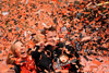 Matt Cain with his wife Chelsea and young daughter Hartley become engulfed in confetti during the San Francisco Giants World Series parade down Market Street in San Francisco.