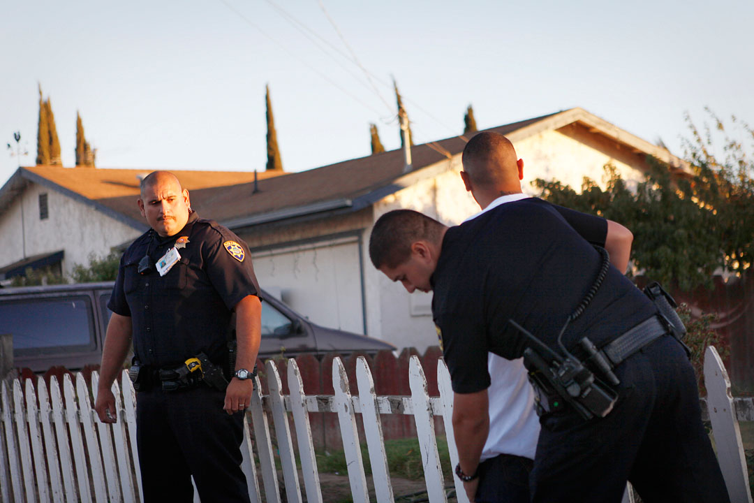Police officer Jose Rodriguez conducts a search after a traffic stop with a car occupied by active gang members September 18, 2010 in Soledad. The four cities of Soledad, Gonzales, Greenfield and King City have a combined population of close 64,000 -- and about 1,500 of those people are gang members, say police. The largest city in the valley, Salinas, has a population of about 145,000 people and  3,500 gang members.