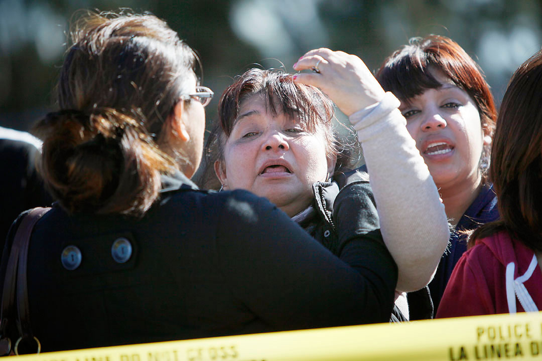 Rita Serrato, center, screams at officers after discovering that her son Rogelio Serrato died during a Monterey County Sheriff's SWAT operation January 4, 2011 in his home along San Antonio Drive in Greenfield. The sheriff was searching for the suspects of a shooting at the Mucky Duck bar in Monterey. While Rogelio Serrato was a registered gang member with connections to the Norteno criminal organization, he was not a suspect in the shooting.