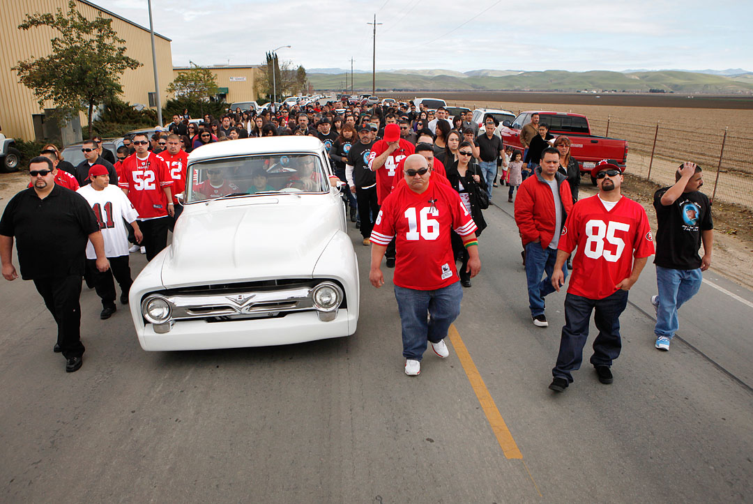 Family, friends and Norteno gang associates of Rogelio Serrato begin his funeral procession towards Greenfield Holy Trinity Cemetery on January 13, 2011 in Greenfield.