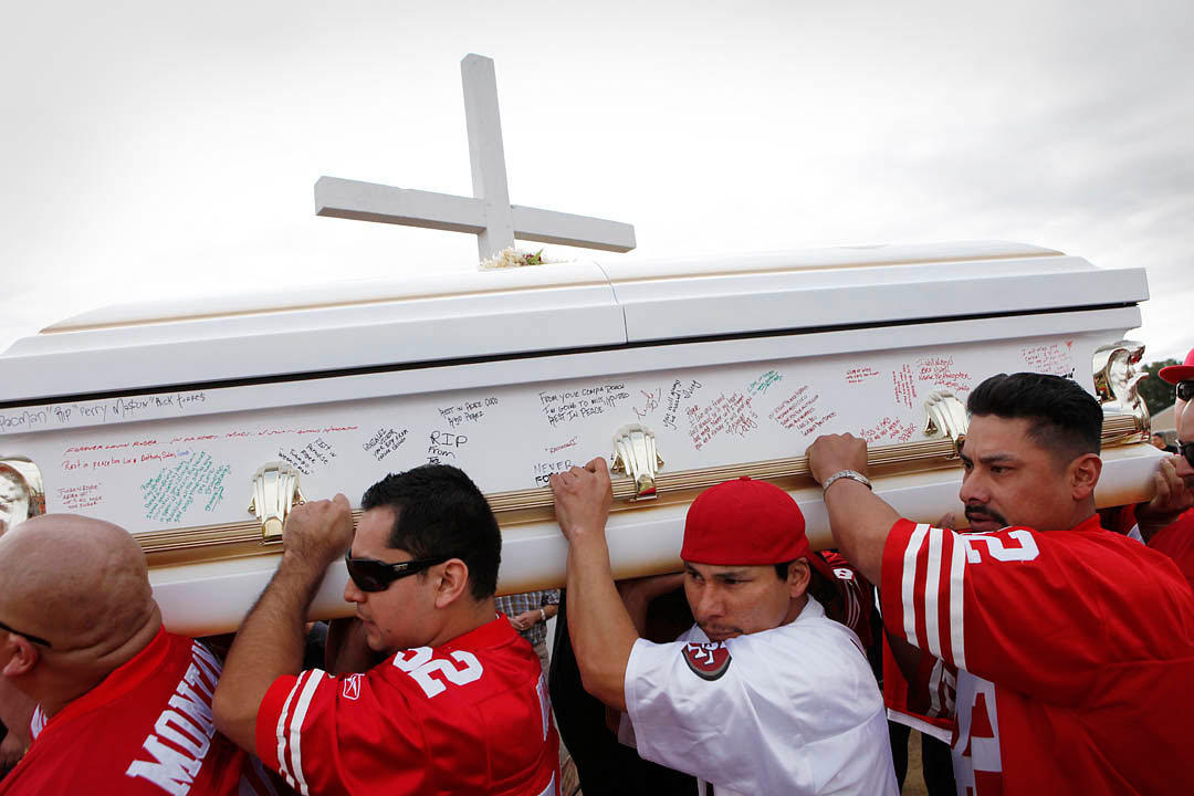 The pallbearers for Rogelio Serrato carry his coffin to carry him into Greenfield Holy Trinity Cemetery on January 13, 2011 in Greenfield.