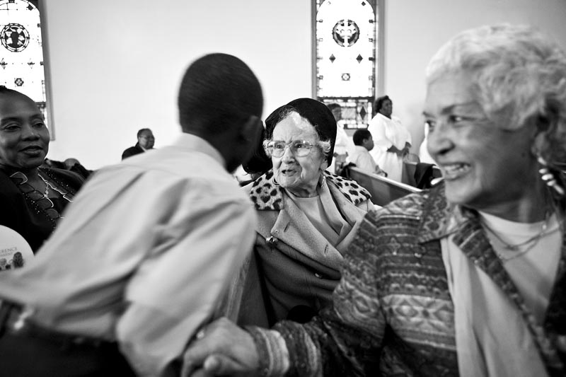 Surrounded by friends and family at Mt. Pisgah Church in Jersey City, Grace Linkhorn and her daughter Gloria Salley talk and socialize. {quote}Everyone knows us,{quote} said Salley. The family has deep roots within the Jersey City community.