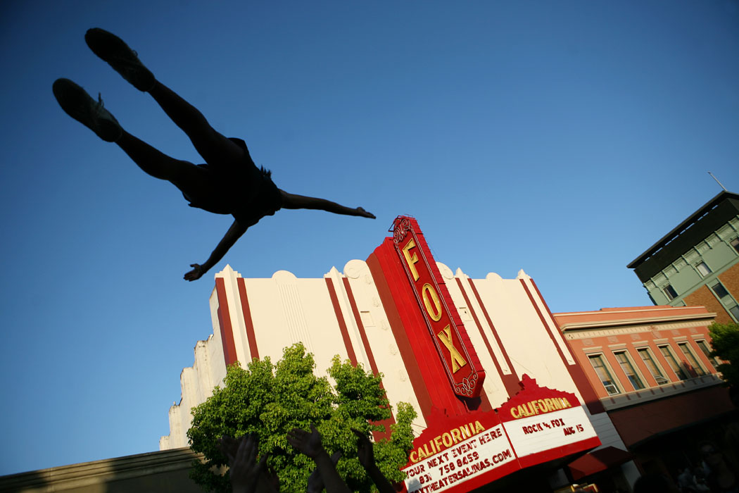 Raymonica Ballio, 14, of Seaside flies through the air in front of the Fox Theater as a part of the Riptide All Stars Cheerleading group during Tuesday's Kiddie Kapers Parade in Oldtown Salinas.
