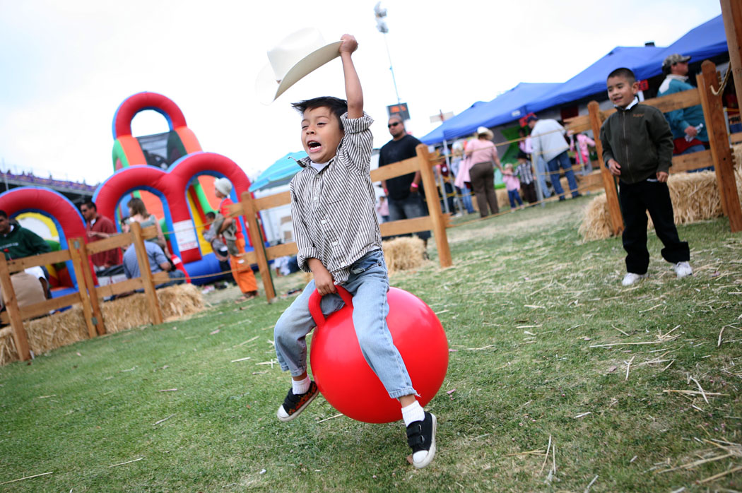 Jeremy Gomez, 5, of Salinas rides a bouncy ball in the Kid's Corral during Thursday's California Rodeo Salinas. The Kid's Corral is free to those attending the Rodeo and offers family friendly entertainment.