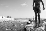 Photograph of favela boys swimming in a canal near Ipanema beach in Rio de Janiero, Brasil.
